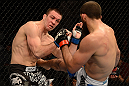 ANAHEIM, CA - FEBRUARY 23:  (R-L) Court McGee kicks Josh Neer in their welterweight bout during UFC 157 at Honda Center on February 23, 2013 in Anaheim, California.  (Photo by Donald Miralle/Zuffa LLC/Zuffa LLC via Getty Images) *** Local Caption *** Court McGee; Josh Neer