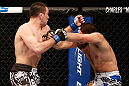 ANAHEIM, CA - FEBRUARY 23:  (L-R) Josh Neer punches Court McGee in their welterweight bout during UFC 157 at Honda Center on February 23, 2013 in Anaheim, California.  (Photo by Josh Hedges/Zuffa LLC/Zuffa LLC via Getty Images) *** Local Caption *** Court McGee; Josh Neer