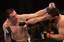 ANAHEIM, CA - FEBRUARY 23:  (L-R) Josh Neer punches Court McGee in their welterweight bout during UFC 157 at Honda Center on February 23, 2013 in Anaheim, California.  (Photo by Donald Miralle/Zuffa LLC/Zuffa LLC via Getty Images) *** Local Caption *** Court McGee; Josh Neer