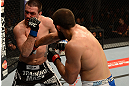 ANAHEIM, CA - FEBRUARY 23:  (R-L) Court McGee punches Josh Neer in their welterweight bout during UFC 157 at Honda Center on February 23, 2013 in Anaheim, California.  (Photo by Donald Miralle/Zuffa LLC/Zuffa LLC via Getty Images) *** Local Caption *** Court McGee; Josh Neer