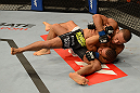 ANAHEIM, CA - FEBRUARY 23:  Ivan Menjivar (black shorts) slams Urijah Faber in their bantamweight bout during UFC 157 at Honda Center on February 23, 2013 in Anaheim, California.  (Photo by Donald Miralle/Zuffa LLC/Zuffa LLC via Getty Images) *** Local Caption *** Urijah Faber; Ivan Menjivar