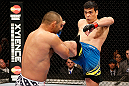 ANAHEIM, CA - FEBRUARY 23:  (R-L) Lyoto Machida kicks Dan Henderson in their light heavyweight bout during UFC 157 at Honda Center on February 23, 2013 in Anaheim, California.  (Photo by Josh Hedges/Zuffa LLC/Zuffa LLC via Getty Images) *** Local Caption *** Lyoto Machida; Dan Henderson