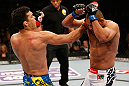 ANAHEIM, CA - FEBRUARY 23:  (L-R) Lyoto Machida punches Dan Henderson in their light heavyweight bout during UFC 157 at Honda Center on February 23, 2013 in Anaheim, California.  (Photo by Josh Hedges/Zuffa LLC/Zuffa LLC via Getty Images) *** Local Caption *** Lyoto Machida; Dan Henderson