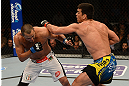 ANAHEIM, CA - FEBRUARY 23:  (R-L) Lyoto Machida punches Dan Henderson in their light heavyweight bout during UFC 157 at Honda Center on February 23, 2013 in Anaheim, California.  (Photo by Donald Miralle/Zuffa LLC/Zuffa LLC via Getty Images) *** Local Caption *** Lyoto Machida; Dan Henderson