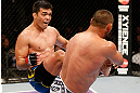 ANAHEIM, CA - FEBRUARY 23:  (L-R) Lyoto Machida kicks Dan Henderson in their light heavyweight bout during UFC 157 at Honda Center on February 23, 2013 in Anaheim, California.  (Photo by Josh Hedges/Zuffa LLC/Zuffa LLC via Getty Images) *** Local Caption *** Lyoto Machida; Dan Henderson