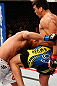 ANAHEIM, CA - FEBRUARY 23:  (R-L) Lyoto Machida knees Dan Henderson in their light heavyweight bout during UFC 157 at Honda Center on February 23, 2013 in Anaheim, California.  (Photo by Josh Hedges/Zuffa LLC/Zuffa LLC via Getty Images) *** Local Caption *** Lyoto Machida; Dan Henderson
