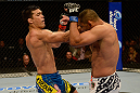 ANAHEIM, CA - FEBRUARY 23:  (L-R) Lyoto Machida punches Dan Henderson in their light heavyweight bout during UFC 157 at Honda Center on February 23, 2013 in Anaheim, California.  (Photo by Donald Miralle/Zuffa LLC/Zuffa LLC via Getty Images) *** Local Caption *** Lyoto Machida; Dan Henderson