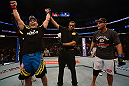 ANAHEIM, CA - FEBRUARY 23:  Lyoto Machida (left) reacts to being declared the winner over Dan Henderson in their light heavyweight bout during UFC 157 at Honda Center on February 23, 2013 in Anaheim, California.  (Photo by Donald Miralle/Zuffa LLC/Zuffa LLC via Getty Images) *** Local Caption *** Lyoto Machida; Dan Henderson
