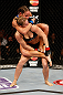 ANAHEIM, CA - FEBRUARY 23:  Liz Carmouche (top) attempts to submit Ronda Rousey in their women&#39;s bantamweight title fight during UFC 157 at Honda Center on February 23, 2013 in Anaheim, California.  (Photo by Josh Hedges/Zuffa LLC/Zuffa LLC via Getty Images) *** Local Caption *** Ronda Rousey; Liz Carmouche