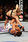 ANAHEIM, CA - FEBRUARY 23:  Ronda Rousey (top) punches Liz Carmouche in their women&#39;s bantamweight title fight during UFC 157 at Honda Center on February 23, 2013 in Anaheim, California.  (Photo by Josh Hedges/Zuffa LLC/Zuffa LLC via Getty Images) *** Local Caption *** Ronda Rousey; Liz Carmouche