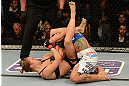 ANAHEIM, CA - FEBRUARY 23:  Ronda Rousey (left) attempts to submit Liz Carmouche in their women's bantamweight title fight during UFC 157 at Honda Center on February 23, 2013 in Anaheim, California.  (Photo by Donald Miralle/Zuffa LLC/Zuffa LLC via Getty Images) *** Local Caption *** Ronda Rousey; Liz Carmouche