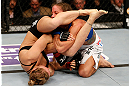 ANAHEIM, CA - FEBRUARY 23:  Ronda Rousey (left) attempts to submit Liz Carmouche in their women&#39;s bantamweight title fight during UFC 157 at Honda Center on February 23, 2013 in Anaheim, California.  (Photo by Josh Hedges/Zuffa LLC/Zuffa LLC via Getty Images) *** Local Caption *** Ronda Rousey; Liz Carmouche