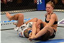ANAHEIM, CA - FEBRUARY 23:  Ronda Rousey (right) attempts to submit Liz Carmouche in their women's bantamweight title fight during UFC 157 at Honda Center on February 23, 2013 in Anaheim, California.  (Photo by Donald Miralle/Zuffa LLC/Zuffa LLC via Getty Images) *** Local Caption *** Ronda Rousey; Liz Carmouche