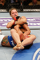 ANAHEIM, CA - FEBRUARY 23:  Ronda Rousey (top) attempts to submit Liz Carmouche in their women's bantamweight title fight during UFC 157 at Honda Center on February 23, 2013 in Anaheim, California.  (Photo by Josh Hedges/Zuffa LLC/Zuffa LLC via Getty Images) *** Local Caption *** Ronda Rousey; Liz Carmouche