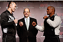 TOKYO, JAPAN - FEBRUARY 28: (L-R) Opponents Yushin Okami and Hector Lombard face off during a UFC press conference at the Hilton Sjinjuku Hotel on February 28, 2013 in Tokyo, Japan. (Photo by Josh Hedges/Zuffa LLC/Zuffa LLC via Getty Images)