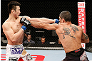 SAITAMA, JAPAN - MARCH 03:  (R-L) Marcelo Guimaraes and Hyun Gyu Lim trade punches in their welterweight fight during the UFC on FUEL TV event at Saitama Super Arena on March 3, 2013 in Saitama, Japan.  (Photo by Josh Hedges/Zuffa LLC/Zuffa LLC via Getty Images)
