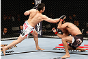 SAITAMA, JAPAN - MARCH 03:  (L-R) Hyun Gyu Lim punches Marcelo Guimaraes in their welterweight fight during the UFC on FUEL TV event at Saitama Super Arena on March 3, 2013 in Saitama, Japan.  (Photo by Josh Hedges/Zuffa LLC/Zuffa LLC via Getty Images)