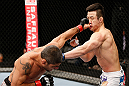 SAITAMA, JAPAN - MARCH 03:  (L-R) Marcelo Guimaraes punches Hyun Gyu Lim in their welterweight fight during the UFC on FUEL TV event at Saitama Super Arena on March 3, 2013 in Saitama, Japan.  (Photo by Josh Hedges/Zuffa LLC/Zuffa LLC via Getty Images)