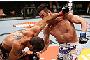 SAITAMA, JAPAN - MARCH 03:  (R-L) Hyun Gyu Lim punches Marcelo Guimaraes in their welterweight fight during the UFC on FUEL TV event at Saitama Super Arena on March 3, 2013 in Saitama, Japan.  (Photo by Josh Hedges/Zuffa LLC/Zuffa LLC via Getty Images)