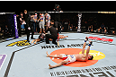 SAITAMA, JAPAN - MARCH 03:  Hyun Gyu Lim reacts after knocking out Marcelo Guimaraes in their welterweight fight during the UFC on FUEL TV event at Saitama Super Arena on March 3, 2013 in Saitama, Japan.  (Photo by Josh Hedges/Zuffa LLC/Zuffa LLC via Getty Images)