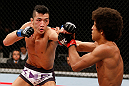 SAITAMA, JAPAN - MARCH 03:  (L-R) Kyung Ho Kang punches Alex Caceres in their bantamweight fight during the UFC on FUEL TV event at Saitama Super Arena on March 3, 2013 in Saitama, Japan.  (Photo by Josh Hedges/Zuffa LLC/Zuffa LLC via Getty Images)
