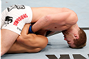 SAITAMA, JAPAN - MARCH 03:  Bryan Caraway (top) attempts to submit Takeya Mizugaki with a guillotine choke in their bantamweight fight during the UFC on FUEL TV event at Saitama Super Arena on March 3, 2013 in Saitama, Japan.  (Photo by Josh Hedges/Zuffa LLC/Zuffa LLC via Getty Images)