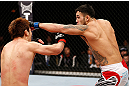 SAITAMA, JAPAN - MARCH 03:  (R-L) Brad Tavares punches Riki Fukuda in their middleweight fight during the UFC on FUEL TV event at Saitama Super Arena on March 3, 2013 in Saitama, Japan.  (Photo by Josh Hedges/Zuffa LLC/Zuffa LLC via Getty Images)