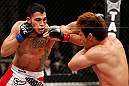 SAITAMA, JAPAN - MARCH 03:  (L-R) Brad Tavares punches Riki Fukuda in their middleweight fight during the UFC on FUEL TV event at Saitama Super Arena on March 3, 2013 in Saitama, Japan.  (Photo by Josh Hedges/Zuffa LLC/Zuffa LLC via Getty Images)