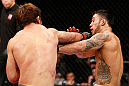 SAITAMA, JAPAN - MARCH 03:  (L-R) Riki Fukuda punches Brad Tavares in their middleweight fight during the UFC on FUEL TV event at Saitama Super Arena on March 3, 2013 in Saitama, Japan.  (Photo by Josh Hedges/Zuffa LLC/Zuffa LLC via Getty Images)