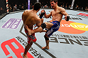 SAITAMA, JAPAN - MARCH 03:  (R-L) Riki Fukuda kicks Brad Tavares in their middleweight fight during the UFC on FUEL TV event at Saitama Super Arena on March 3, 2013 in Saitama, Japan.  (Photo by Josh Hedges/Zuffa LLC/Zuffa LLC via Getty Images)