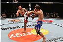 SAITAMA, JAPAN - MARCH 03:  (L-R) Brad Tavares kicks Riki Fukuda in their middleweight fight during the UFC on FUEL TV event at Saitama Super Arena on March 3, 2013 in Saitama, Japan.  (Photo by Josh Hedges/Zuffa LLC/Zuffa LLC via Getty Images)