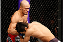 SAITAMA, JAPAN - MARCH 03:  (L-R) Siyar Bahadurzada punches Dong Hyun Kim in their welterweight fight during the UFC on FUEL TV event at Saitama Super Arena on March 3, 2013 in Saitama, Japan.  (Photo by Josh Hedges/Zuffa LLC/Zuffa LLC via Getty Images)