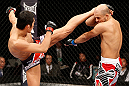 SAITAMA, JAPAN - MARCH 03:  (L-R) Dong Hyun Kim kicks Siyar Bahadurzada in their welterweight fight during the UFC on FUEL TV event at Saitama Super Arena on March 3, 2013 in Saitama, Japan.  (Photo by Josh Hedges/Zuffa LLC/Zuffa LLC via Getty Images)