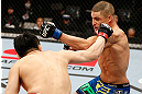 SAITAMA, JAPAN - MARCH 03:  (R-L) Diego Sanchez and Takanori Gomi trade punches in their lightweight fight during the UFC on FUEL TV event at Saitama Super Arena on March 3, 2013 in Saitama, Japan.  (Photo by Josh Hedges/Zuffa LLC/Zuffa LLC via Getty Images)
