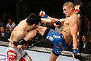 SAITAMA, JAPAN - MARCH 03:  (R-L) Diego Sanchez kicks Takanori Gomi in their lightweight fight during the UFC on FUEL TV event at Saitama Super Arena on March 3, 2013 in Saitama, Japan.  (Photo by Josh Hedges/Zuffa LLC/Zuffa LLC via Getty Images)