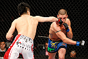 SAITAMA, JAPAN - MARCH 03:  (L-R) Takanori Gomi punches Diego Sanchez in their lightweight fight during the UFC on FUEL TV event at Saitama Super Arena on March 3, 2013 in Saitama, Japan.  (Photo by Josh Hedges/Zuffa LLC/Zuffa LLC via Getty Images)