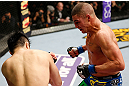 SAITAMA, JAPAN - MARCH 03:  (R-L) Diego Sanchez punches Takanori Gomi in their lightweight fight during the UFC on FUEL TV event at Saitama Super Arena on March 3, 2013 in Saitama, Japan.  (Photo by Josh Hedges/Zuffa LLC/Zuffa LLC via Getty Images)
