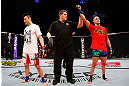 SAITAMA, JAPAN - MARCH 03:  Diego Sanchez (R) reacts after defeating Takanori Gomi (L) in their lightweight fight during the UFC on FUEL TV event at Saitama Super Arena on March 3, 2013 in Saitama, Japan.  (Photo by Josh Hedges/Zuffa LLC/Zuffa LLC via Getty Images)