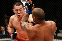 SAITAMA, JAPAN - MARCH 03:  (L-R) Yushin Okami punches Hector Lombard in their middleweight fight during the UFC on FUEL TV event at Saitama Super Arena on March 3, 2013 in Saitama, Japan.  (Photo by Josh Hedges/Zuffa LLC/Zuffa LLC via Getty Images)