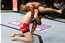 SAITAMA, JAPAN - MARCH 03:  (L-R) Yushin Okami takes down Hector Lombard in their middleweight fight during the UFC on FUEL TV event at Saitama Super Arena on March 3, 2013 in Saitama, Japan.  (Photo by Josh Hedges/Zuffa LLC/Zuffa LLC via Getty Images)