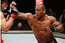 SAITAMA, JAPAN - MARCH 03:  (R-L) Hector Lombard punches Yushin Okami in their middleweight fight during the UFC on FUEL TV event at Saitama Super Arena on March 3, 2013 in Saitama, Japan.  (Photo by Josh Hedges/Zuffa LLC/Zuffa LLC via Getty Images)