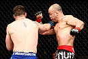 SAITAMA, JAPAN - MARCH 03:  (L-R) Brian Stann punches Wanderlei Silva in their light heavyweight fight during the UFC on FUEL TV event at Saitama Super Arena on March 3, 2013 in Saitama, Japan.  (Photo by Josh Hedges/Zuffa LLC/Zuffa LLC via Getty Images)