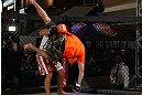 MONTREAL, QC - MARCH 13:  Johny Hendricks (L) conducts an open training session for fans and media ahead of his UFC 158 bout at Complexe Desjardins on March 13, 2013 in Montreal, Quebec, Canada.  (Photo by Josh Hedges/Zuffa LLC/Zuffa LLC via Getty Images)
