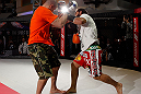 MONTREAL, QC - MARCH 13:  Johny Hendricks (R) conducts an open training session for fans and media ahead of his UFC 158 bout at Complexe Desjardins on March 13, 2013 in Montreal, Quebec, Canada.  (Photo by Josh Hedges/Zuffa LLC/Zuffa LLC via Getty Images)