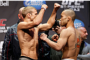 MONTREAL, QC - MARCH 15: (L-R) T.J. Dillashaw faces off with Issei Tamura during the UFC 158 weigh-in at Bell Centre on March 15, 2013 in Montreal, Quebec, Canada.  (Photo by Josh Hedges/Zuffa LLC/Zuffa LLC via Getty Images)
