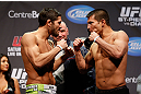 MONTREAL, QC - MARCH 15: (L-R) Patrick Cote faces off with Bobby Voelker during the UFC 158 weigh-in at Bell Centre on March 15, 2013 in Montreal, Quebec, Canada.  (Photo by Josh Hedges/Zuffa LLC/Zuffa LLC via Getty Images)