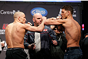 MONTREAL, QC - MARCH 15: Georges St-Pierre (L) and Nick Diaz (R) face off during the UFC 158 weigh-in at Bell Centre on March 15, 2013 in Montreal, Quebec, Canada.  (Photo by Josh Hedges/Zuffa LLC/Zuffa LLC via Getty Images)