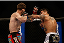 MONTREAL, QC - MARCH 16: Reuben Duran lands a punch against George Roop in their bantamweight bout during the UFC 158 event at Bell Centre on March 16, 2013 in Montreal, Quebec, Canada.  (Photo by Josh Hedges/Zuffa LLC/Zuffa LLC via Getty Images)