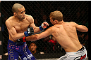 MONTREAL, QC - MARCH 16:  (R-L) T.J. Dillashaw lands a punch on Issei Tamura in their bantamweight bout during the UFC 158 event at Bell Centre on March 16, 2013 in Montreal, Quebec, Canada.  (Photo by Jonathan Ferrey/Zuffa LLC/Zuffa LLC via Getty Images)