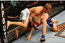 MONTREAL, QC - MARCH 16:  (L-R) T.J. Dillashaw grapples with Issei Tamura in their bantamweight bout during the UFC 158 event at Bell Centre on March 16, 2013 in Montreal, Quebec, Canada.  (Photo by Jonathan Ferrey/Zuffa LLC/Zuffa LLC via Getty Images)